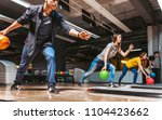 friends bowling at club and... | Shutterstock . vector #1104423662