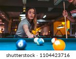 young woman playing pool with... | Shutterstock . vector #1104423716