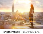 young woman looking at the city ... | Shutterstock . vector #1104430178