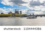 ships on river thames in london ... | Shutterstock . vector #1104444386