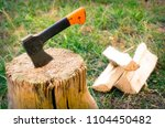 old ax in a stump | Shutterstock . vector #1104450482
