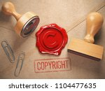 Copyright rubber stamp  and sealing wax stamrp on the craft peper.  Intellectual property and copyright concept. 3d illustration