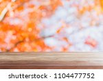 empty wood table top and... | Shutterstock . vector #1104477752