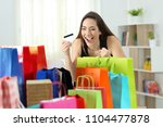 excited shopper looking at... | Shutterstock . vector #1104477878