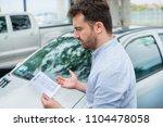 surprised man finding parking... | Shutterstock . vector #1104478058