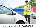 one parking warden writing a... | Shutterstock . vector #1104478082