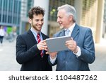 business people using a tablet... | Shutterstock . vector #1104487262