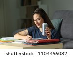 happy student taking notes... | Shutterstock . vector #1104496082