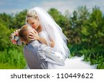 groom and bride in a park.... | Shutterstock . vector #110449622