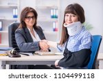 injured employee visiting... | Shutterstock . vector #1104499118
