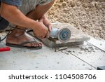 Small photo of Worker man grind hard floor. Worker with high shear grinder cut and mill. To cut a cement plate. While cutting it has fire spark. Danger job.