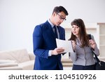 real estate agent showing new... | Shutterstock . vector #1104510926