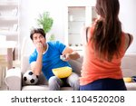 wife unhappy that husband is... | Shutterstock . vector #1104520208