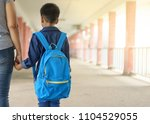 boy going to school with his...   Shutterstock . vector #1104529055