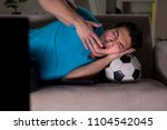 young man watching football... | Shutterstock . vector #1104542045