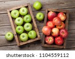 ripe green and red apples in... | Shutterstock . vector #1104559112