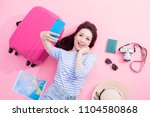 travel woman selfie happily on... | Shutterstock . vector #1104580868
