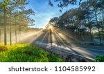 sun rays shining down through... | Shutterstock . vector #1104585992