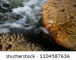 abstract natural rocky... | Shutterstock . vector #1104587636
