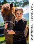young horse riding girl ... | Shutterstock . vector #1104601442