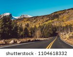 highway at autumn sunny day in... | Shutterstock . vector #1104618332