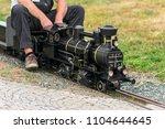 man siting on old mini train....   Shutterstock . vector #1104644645