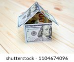 dollars money in the shape of a ...   Shutterstock . vector #1104674096