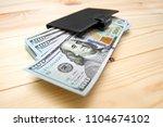 heap of money and wallet. money ...   Shutterstock . vector #1104674102