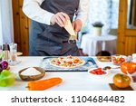 closeup hands of chef making...   Shutterstock . vector #1104684482