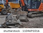 Small photo of LONDON, UK - CIRCA FEBRUARY 2018: excavator mechanical shovel digger digging in a building site