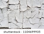 old cracked paint of gray color.... | Shutterstock . vector #1104699935