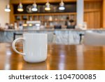 cup of coffee on table with... | Shutterstock . vector #1104700085