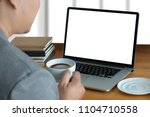 laptop with blank screen on... | Shutterstock . vector #1104710558