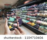 family in the supermarket use... | Shutterstock . vector #1104710606