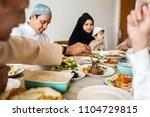 muslim family having a ramadan... | Shutterstock . vector #1104729815