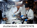 chef working on the kitchen | Shutterstock . vector #1104757478