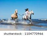 girl galopading through the... | Shutterstock . vector #1104770966