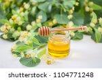 jar of fresh honey with flowers ... | Shutterstock . vector #1104771248