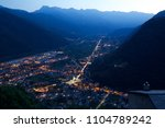 italy town at night in the alps ... | Shutterstock . vector #1104789242