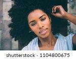 beautiful young black woman... | Shutterstock . vector #1104800675