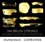 set of golden paint strokes to... | Shutterstock .eps vector #1104814436