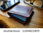 wallet with credit cards inside | Shutterstock . vector #1104821855