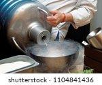 chef is pouring liquid nitroden ... | Shutterstock . vector #1104841436