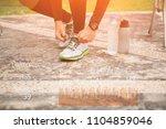 exercising man notifications on ... | Shutterstock . vector #1104859046