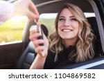 an attractive woman in a car... | Shutterstock . vector #1104869582