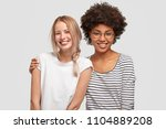 two beautiful mutiethnic... | Shutterstock . vector #1104889208