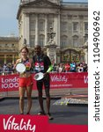 Small photo of London,UK,May 28th 2018,Vitality London 10,000 takes place in London. Winners Steph Twell, Sir Mo Farah pose with their trophies and Jessica Ennis-Hill.