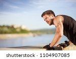 strong hand  of muscular man... | Shutterstock . vector #1104907085