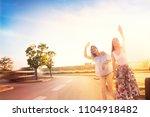 two friends on a road trip ... | Shutterstock . vector #1104918482