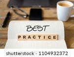 closeup on notebook over wood... | Shutterstock . vector #1104932372